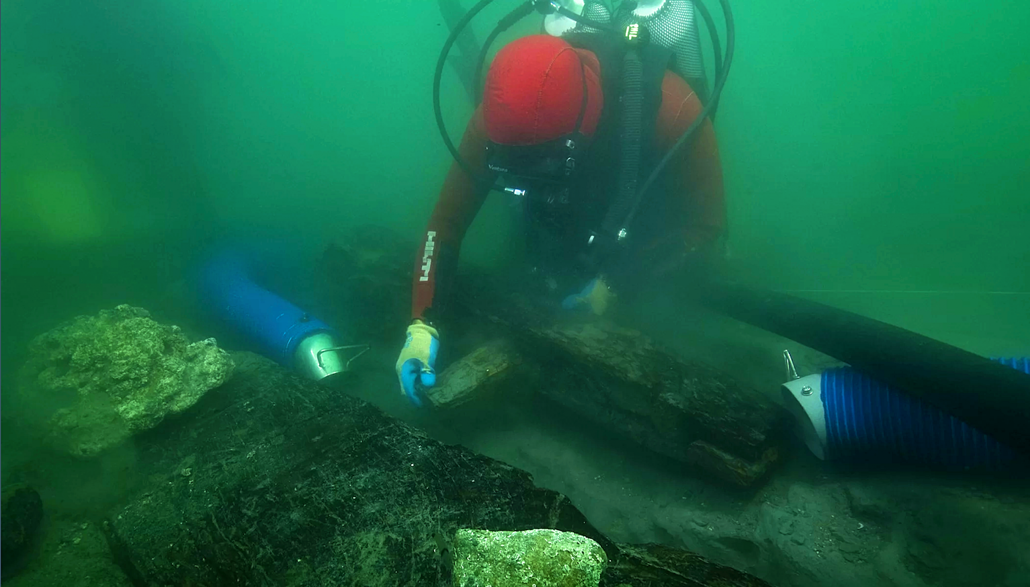 An archaeologist examines how the ancient vessels keel was put together