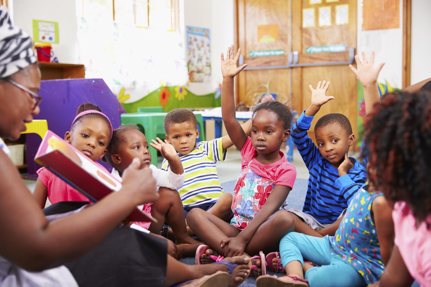 BLACK-PRESCHOOLERS-WITH-TEACHER - Children Reading Listening